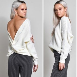 White sweater with twist